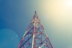 image of Tele-radio tower with blue sky for background usage .