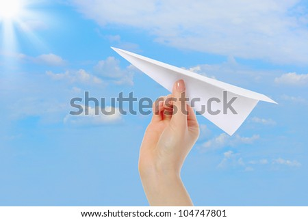 image of the businesswoman throwing white paper plane.