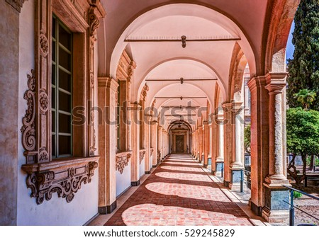 Image of the cloister arches inside a monastery. Architectural background. Сток-фото ©