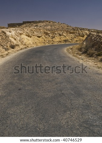 Image of the hill road going through the desert in libyan Jebel Nafussa