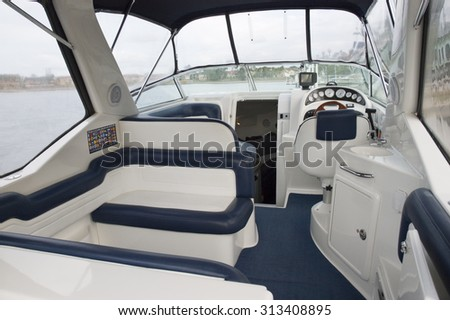 Image of the interior of a small transport motorboat #313408895