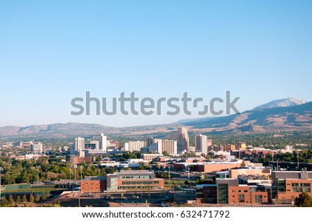 Shutterstock Image of the skyline of Reno, Nevada with the University of Nevada Reno in the foreground.
