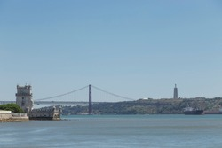 image of the Tagus estuary in Lisbon, we see the 25 de Abril bridge, the Belen tower and the Cristo Rey, undisputed symbols of the city. Portugal, Europe