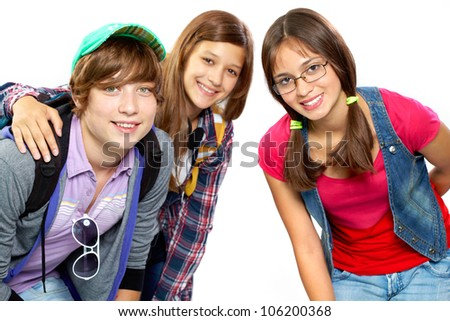 Image of three friends or classmates hugging in front of the cam - stock photo