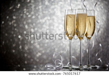 Image of three glasses with wine on gray background #765017617