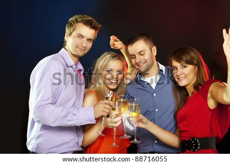 Image of toasting couple clinking glasses with champagne at party