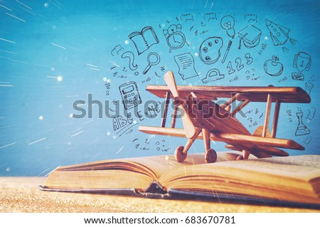 image of toy airplane and book over wooden table with set of back to school infographics. #683670781
