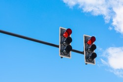image of traffic light, the red light is lit. symbolic  for holding.