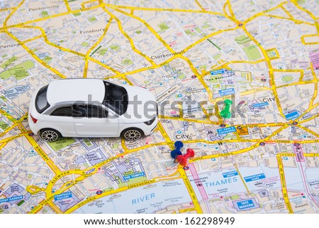Image of travel concept. small car on London city map