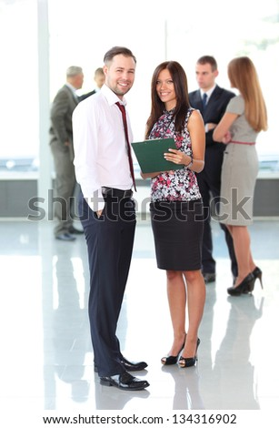 Image of two business partners planning work