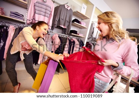 Image of two greedy girls fighting for red tanktop in department store