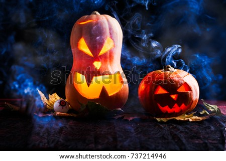 Image of two halloween pumpkins with eyeballs on black background with smoke #737214946