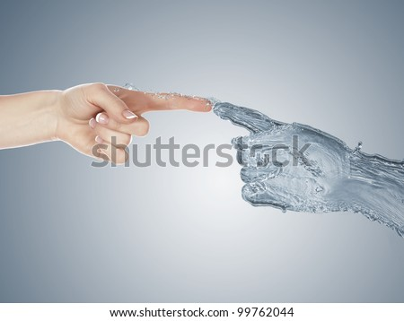 Image of two human hands touching each other