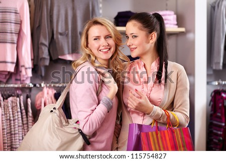 Image of two pretty girls shopping in department store