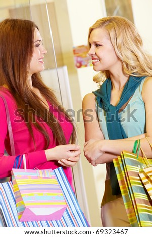 Image of two women talking in shop