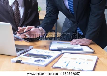Image of two young Asia businessmen using Computer at meeting #1152599057