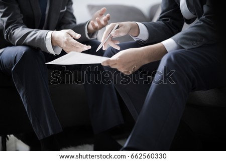 Image of two young businessmen discussing project at meeting #662560330
