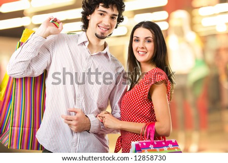 Image of two young people in the shopping mall looking at camera