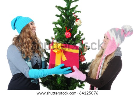 Image of two young women with a New Year gift. Isolated on white background