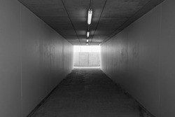 image of underground walk way to the train station in black and white color.