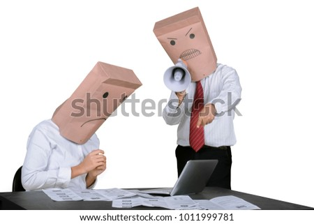 Image of unidentified businessman scolding his worker with a megaphone, isolated on white background