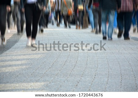 Image of unrecognizable crowd of people shopping in the city street. Motion blur Foto stock ©