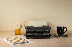 Image of vintage typewriter on wooden table