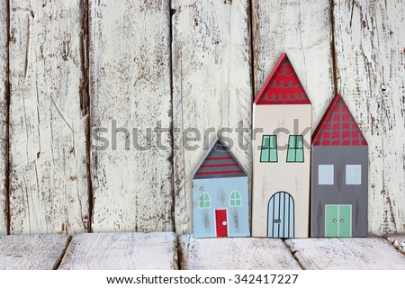 image of vintage wooden colorful houses decoration on wooden table.  #342417227