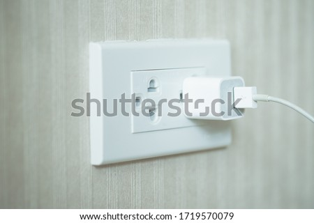 image of white plug in electric socket on wall. Сток-фото ©