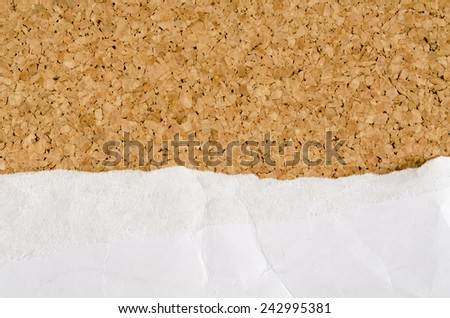 Image of white wrinkle paper ripped on cork background