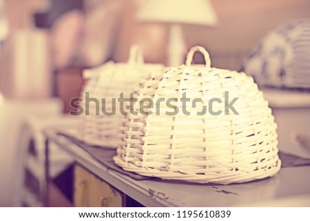 Image of wicker breadbasket in the furniture shop with designer furniture