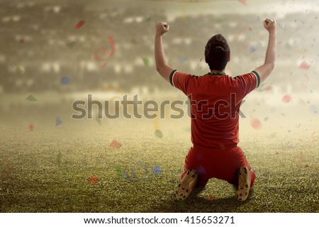 Shutterstock Image of winning football player after score in a match