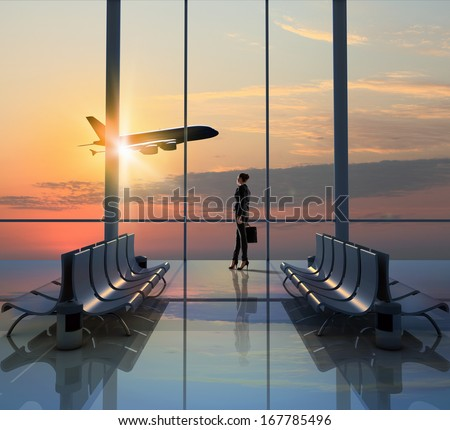 Image of woman in airport looking at taking off airplane #167785496