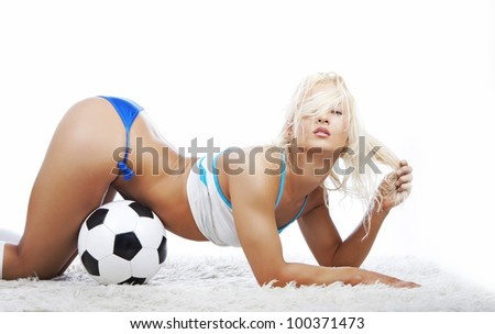 Image of woman with ball posing in studio