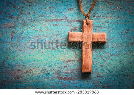 Image of wooden cross on blue retro background #283819868