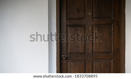 Image of wooden hotel door with white wall background. Foto d'archivio ©