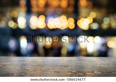 image of wooden table in front of abstract blurred background  #586614677