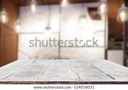 image of wooden table in front of abstract blurred background of resturant lights for display or montage your products.