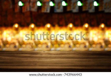 Image of wooden table in front of abstract blurred restaurant lights background. #743966443