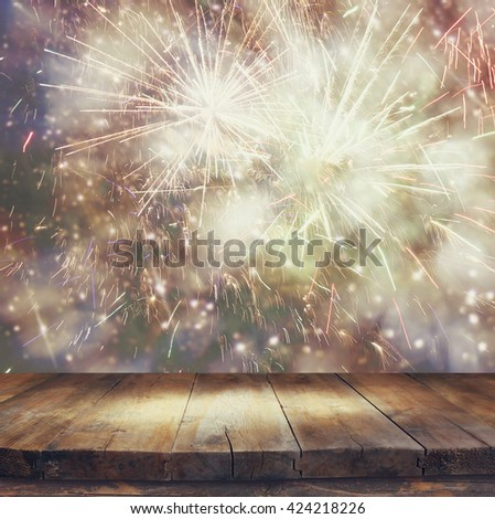 image of wooden table in front of blurred fireworks background  #424218226