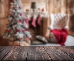 image of wooden table in front of christmas blurred background of interior. can be used for display or montage your products. Mock up for display of product.