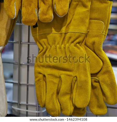 Image of work gloves. Yellow leather gloves.