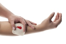 Image of wounded arm with bandage against white background