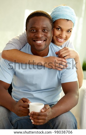 Image of young African couple looking at camera