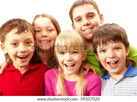 Image of young boys and girls smiling at camera