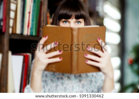 Stock Photo Image of young brunette with book in hand
