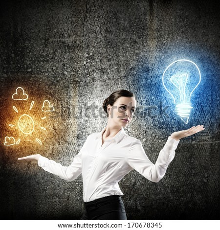 Image of young businesswoman holding bulb on palm