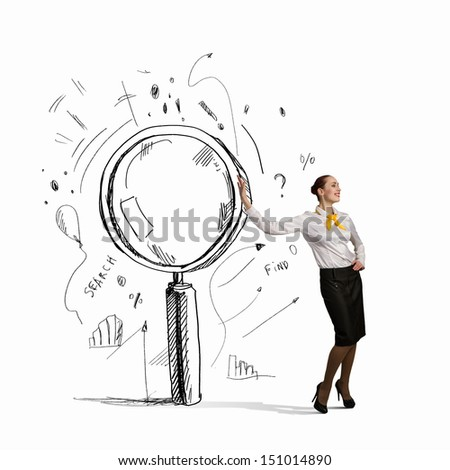 Image of young businesswoman leaning on magnifier