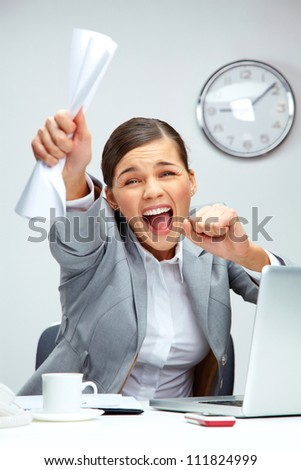 Image of young businesswoman shouting in luck - stock photo
