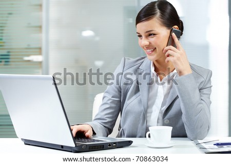 Image of young businesswoman sitting at the table - stock photo